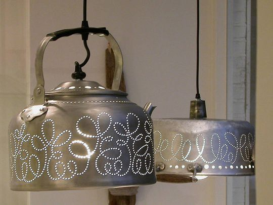 These hanging lights are made out of old tea kettles, cake plate covers, colanders, etc! How cool for a kitchen or patio/porch