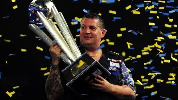 Gary Anderson defeats Adrian Lewis 7-5 to retain his PDC World Darts Championship crown at Alexandra Palace.