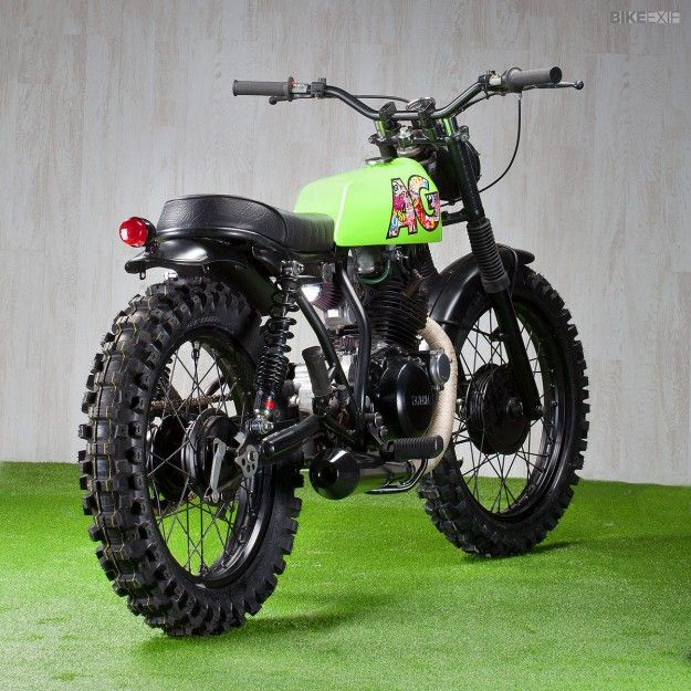 """We've used the term 'low-key' to describe Ad Hoc's David Gonzalez before. His latest release—an audacious Yamaha SR250—is anything but. This cheeky-looking scrambler was built to appeal to the urban and extreme sports sensibilities of its young owner. """"The first thing that came to mind… Read more »"""