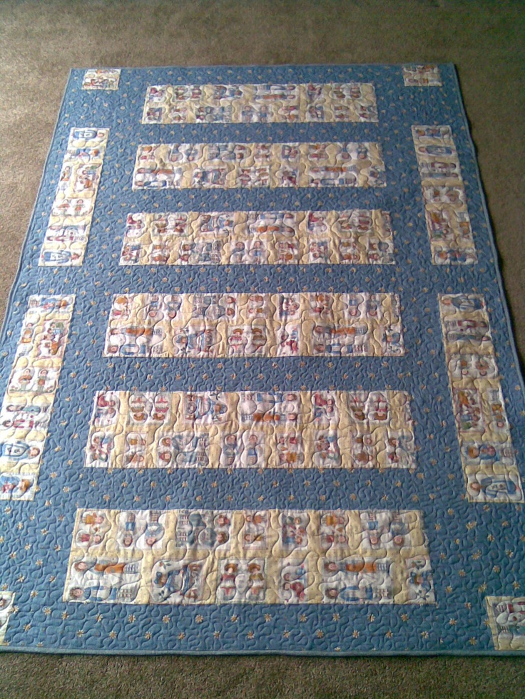 A quilt made for a young child.  This was originally going to be two cot quilts started by a client many years ago.  I unpicked what they had done and remade into a single bed quilt.