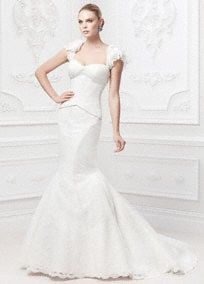 This flutter sleeve lace fit and flare gown is the epitome of glamour and sophisticated elegance!  Chantilly lace flutter sleeve gown features corseted bodice detailing for a seamless and stunning silhouette.  Veiled corded lace fit and flare skirt adds an ultra-feminine and delicate touch.  Flutter sleeves are removable. http://www.davidsbridal.com/Product_Flutter-Sleeve-Corded-Lace-Fit-and-Flare-Gown-ZP345003_Bridal-Gowns-Shop-By-Designer-Truly-Zac-Posen