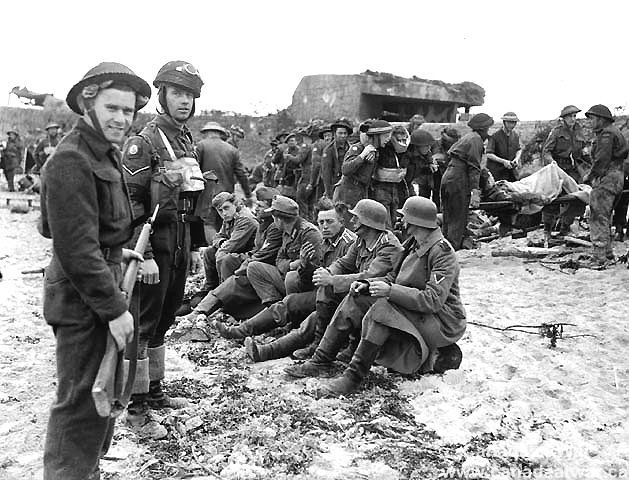 This is an image of Canadian soldiers watching over German prisoners after D-Day. This source is credible as it is an image taken in France immediately after the battle. This tells us about the changing lives of Canadians at the time because it shows that Canadian soldiers were confident in their role during the D-Day accomplishments.