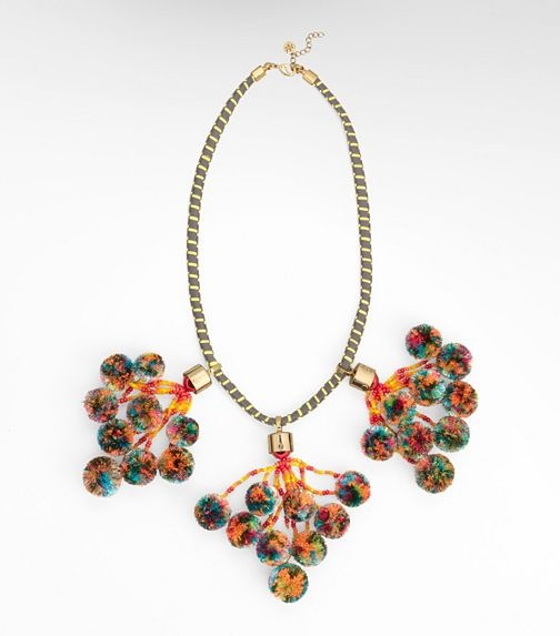 """From Tory Burch.  """"Add a burst of brightness to your look with the outfit-making pom-pom necklace. This fun accessory's Southwest-inspired beading and colorful pom-pom tassels dangling from a yellow-striped cord are guaranteed to transform even the most basic of daily uniforms.""""  $295"""