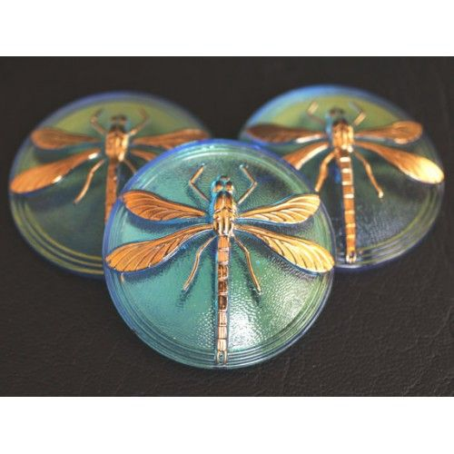 http://www.scarabeads.com/Glass-Buttons/Cabochon-buttons/Czech-Glass-Button-Cabochon-Light-Shapphire-AB-Gold-Dragonfly-size-18
