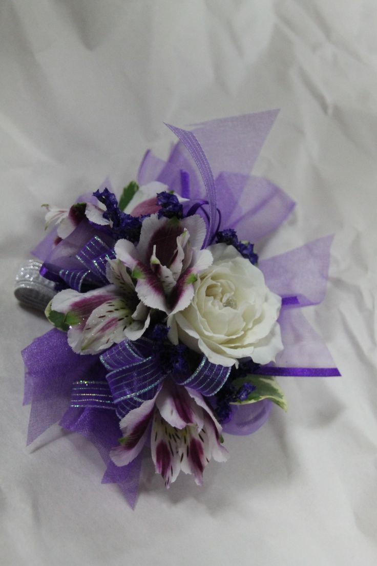 Wrist corsage with ivory garden roses, white & purple alstroemeria. Created by Judith Marie at Fox Bros Floral, Hartland, WI
