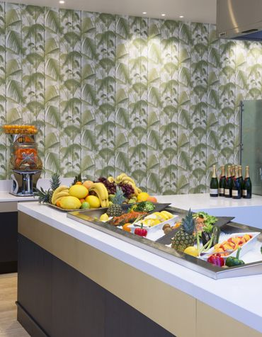 The lunch buffet with palm tree wallpaper. Interior architecture | Ramsoskar