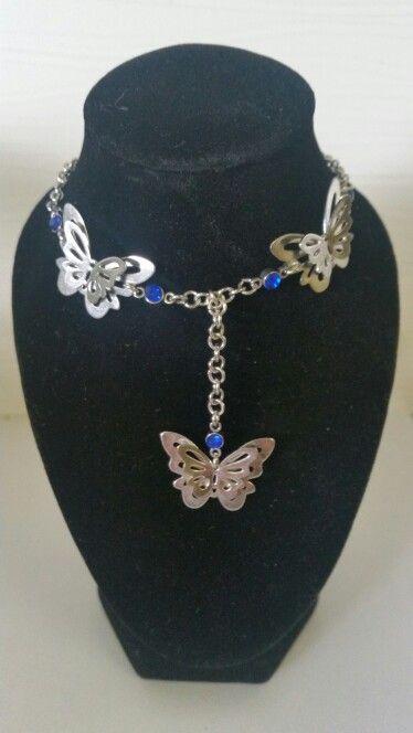 Butterflies with dark blue rhinestones. AUS $18.95