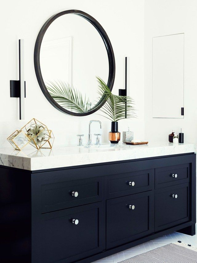 "The Vanity ""We wanted to keep within the house's East Coast architectural influence,"" says Quattrone, who created a modern interpretation of Shaker-style millwork for two adjacent vanities. To mimic the look of a high-end countertop, the designers sourced a less expensive ¾-inch marble slab. ""We mitered the corners and bookmatched the edges to give the illusion of a three-inch-thick surface,"" says Sanders. The slim profile of the Y Lighting LED sconces, which slide up and down for optimal…"