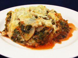 Een heerlijk voedselzandloper recept: Boerenkoolschotel uit de oven, boerenkool, zoete aardappel, knolselderij...