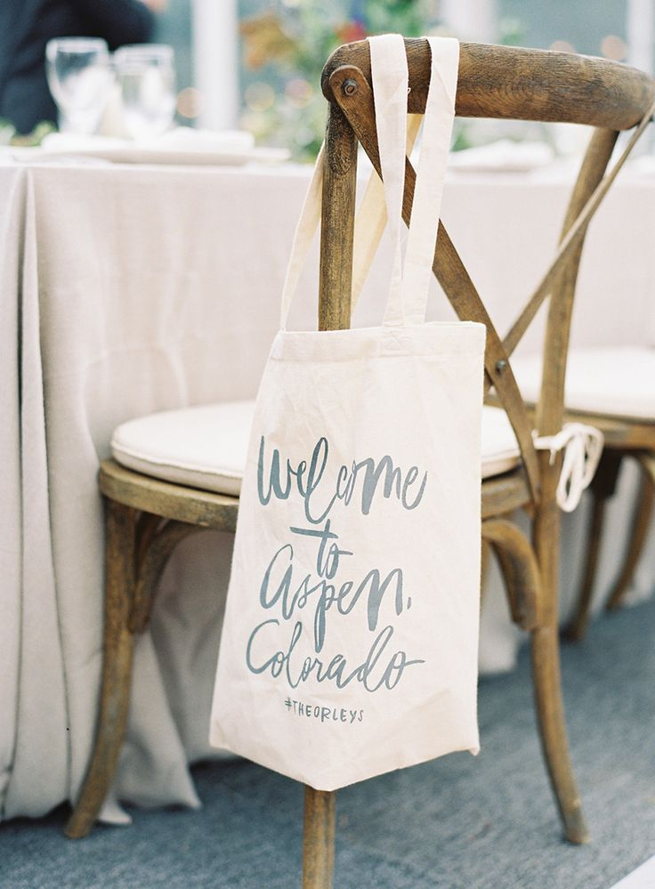Most of the time wedding welcome gifts are placed in your guests room, but we LOVE the unique twist of putting them on the reception chairs! Great touch! Tags: Vouge, Aspen, Colorado wedding, Wedding hashtag, Wedding favors, Wedding Welcome gifts