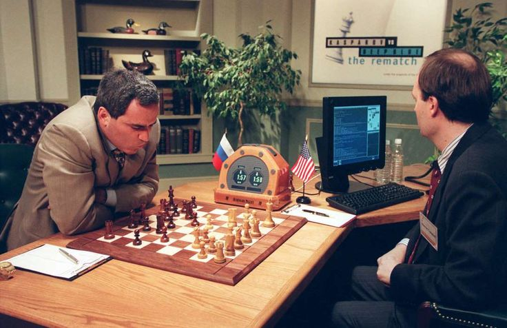 February 10,    1996: Kasparov loses chess game to computer  -   Garry Kasparov ﴾left﴿, is seen before his next move against Deep Blue, IBM's chess playing computer in New York, during game two of their six‐game rematch.