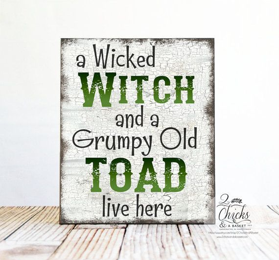 A Wicked Witch And A Grumpy Old Toad Live Here Halloween Sign This sign measures 10x12 inches. All of our signs are handcrafted by us from start to finish. We cut the board to size, professionally print the design, mount it to the board, sand the edges, and seal it for a lifetime of enjoyment. Wire is then attached to the back so you can display your sign as soon as you get it. ............ PRODUCT INFO ........... Our signs are made of ½ inch MDF. MDF is a wood building material that has...