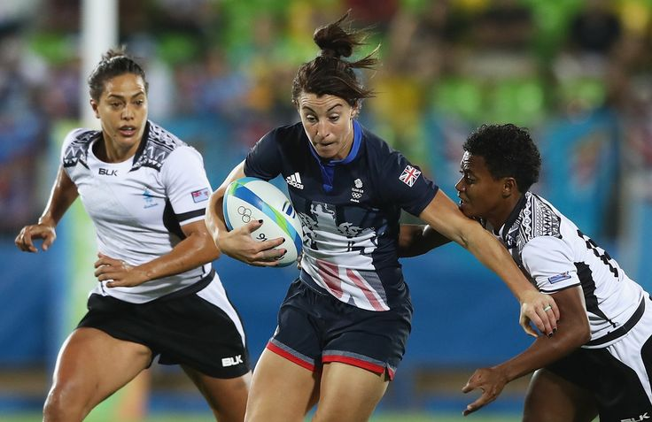 Alice Richardson of Great Britain carries the ball under pressure against Fiji during the Women's Quarterfinal rugby match on Day 2 of the Rio 2016 Olympic Games at Deodoro Stadium on August 7, 2016 in Rio de Janeiro, Brazil.