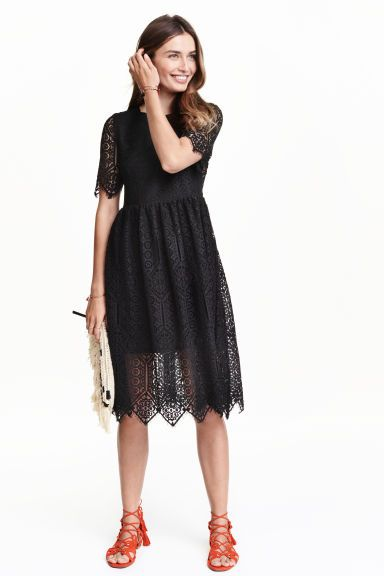 Lace dress: Knee-length, short-sleeved lace dress that is fitted at the top with an opening with a button at the back of the neck, a concealed zip in the side, a seam at the waist and a very wide skirt. Slightly transparent lining.