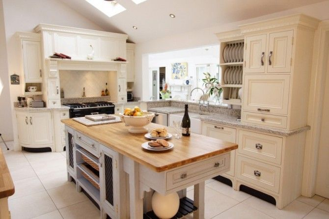 Cream bespoke kitchen in a timeless in-frame step shaker style.