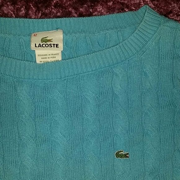 LACOSTE SWEATER Beautiful blue LACOSTE sweater, only flaw is white thredding peeking through on the sleeve as pictured. Good condition. From a smoke-free, pet-free home. Bought from Lacoste outlet in Texas on vacation for $90. Lacoste Sweaters