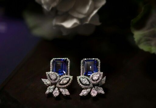 Winter Earings-A pair of Diamond Ear Clips with invisible-set diamonds.