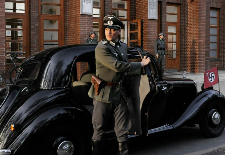 "Fritz Karl as Major Hilmar Dierks, stepping out of his Mercedes 170V limousine in the film ""Die Spionin"", 2013."
