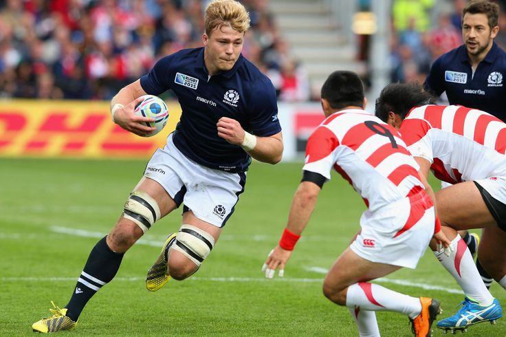 David Denton of Scotland takes on the Japan defence with a burst of speed on the wing. RWC 2015.