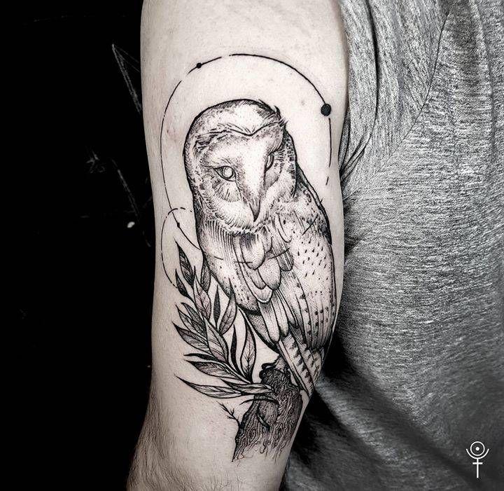 Barn owl tattoo on the back of the left arm. Tattoo Artist: Gabor Zolyomi
