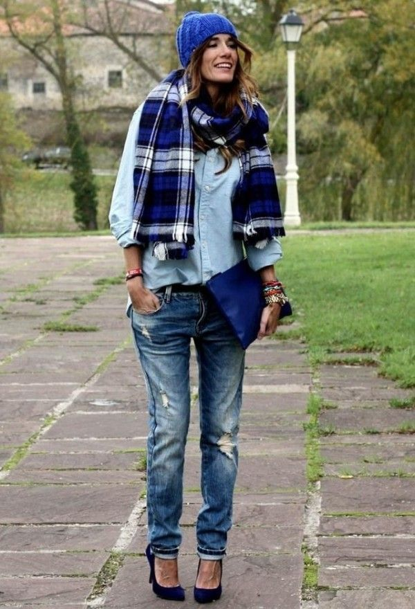 Shop this look on Lookastic:  http://lookastic.com/women/looks/beanie-scarf-dress-shirt-clutch-skinny-jeans-pumps/4124  — Blue Beanie  — Navy and White Plaid Scarf  — Light Blue Denim Dress Shirt  — Navy Leather Clutch  — Navy Ripped Skinny Jeans  — Navy Suede Pumps