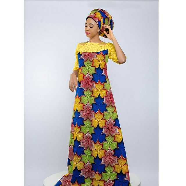 No 11 The winenedress #colourful ankara dress with embelished neckline. N15,000