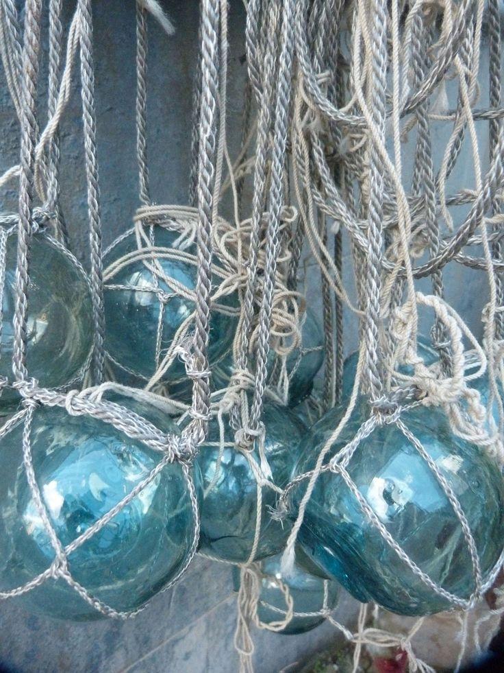 Beachside~glass fishing net floats. http://www.aftershocksinteriordecorating.com/interior-decorating-and-design-blog