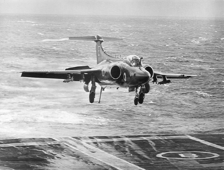 fcba:  A Buccaneer of the Royal Navy lands on the HMS Eagle c. 1971. (Photo)
