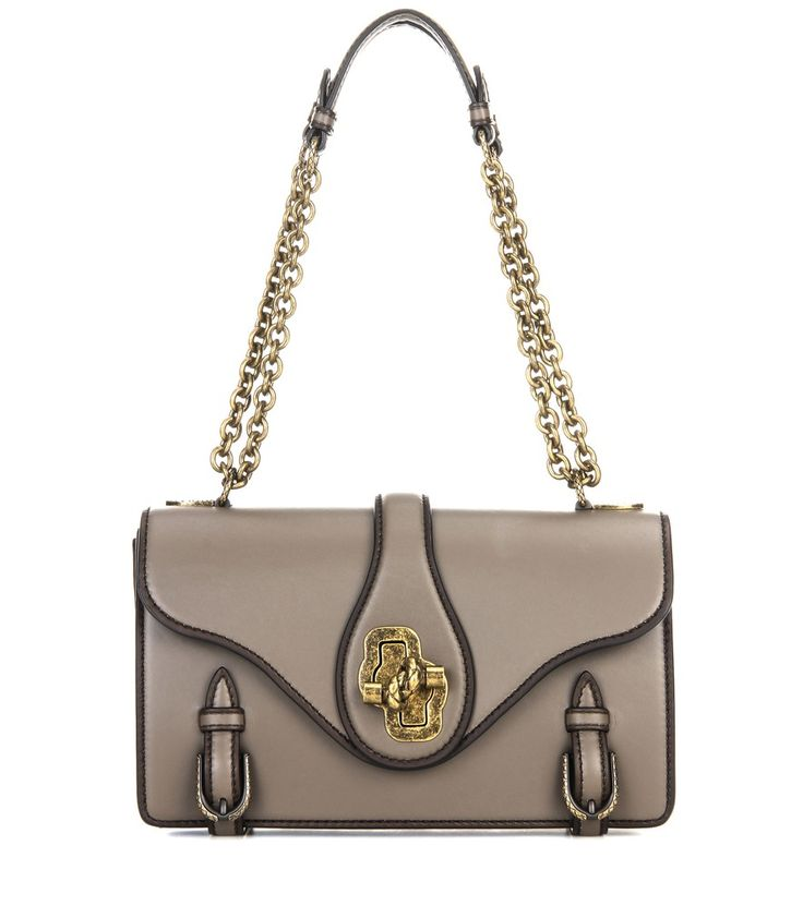 Bottega Veneta - City Knot leather shoulder bag - Crafted from smooth French calfskin, Bottega Veneta's City Knot bag is part of the label's 50th anniversary collection. The clean-cut boxy style is highlighted by hand-painted edges and aged gold-tone hardware. The chain strap is adjustable  – you can carry this piece in hand or drape it elegantly over the shoulder for versatile styling. seen @ www.mytheresa.com