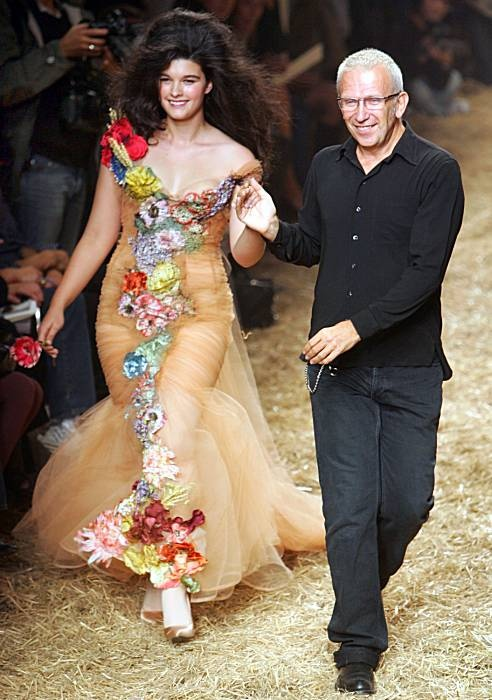 Jean-Paul Gaultier taking the catwalk with model Crystal Renn at the end of the presentation of his Spring/Summer ready to wear 2006 collection in Paris (She is a size 12)