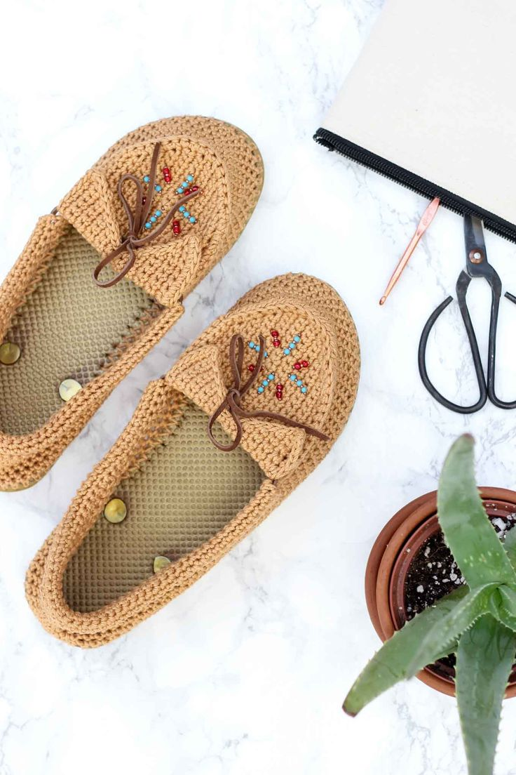 "Learn how to crochet shoes with flip flop soles with this free crochet moccasin pattern and video tutorial! These crochet moccasins with seed bead detailing make super comfortable women's shoes or slippers and can be customized however you wish. Made from Lion Brand 24/7 Cotton in ""Camel"" color."