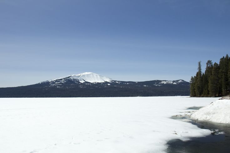 Diamond Lake, Oregon | Lake still covered in snow with Mt. Bailey in background.
