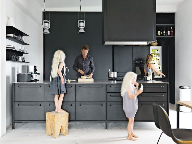Morten Bo Jensen, the chief designer at Vipp, and his partner, graphic designer Kristina May Olsen, call this loft space in Copenhagen home. Their sleek black kitchen was designed by Jensen for Vipp and features a gas stovetop by ABK, a refrigerator by Smeg, and Le Perroquet spotlights from iGuzzini.