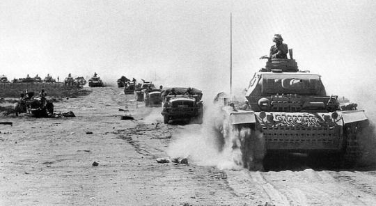 War Pictures from History - Afrika Korps Panzer III Ausf. H leads a column through the Libyan Desert.