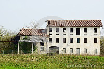 Ruins of an old house without windows in north Italy.