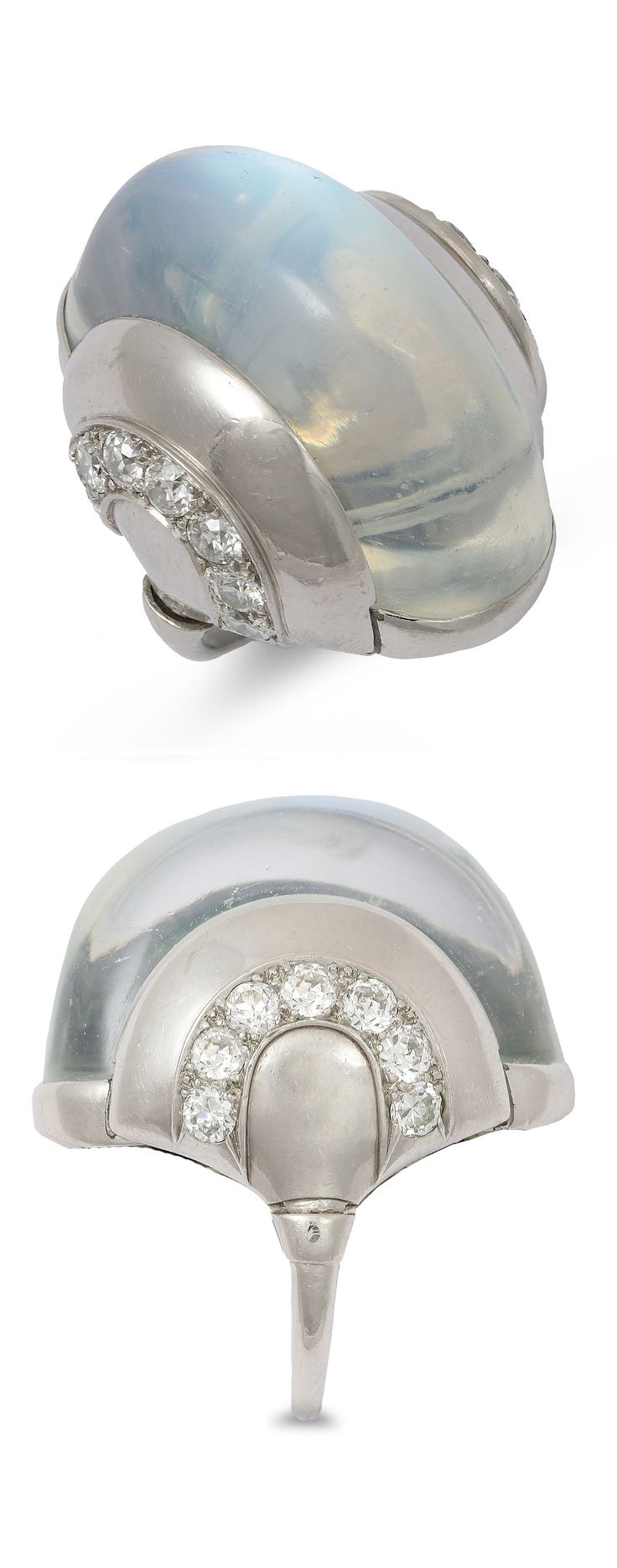 An Art Deco moonstone and diamond ring, 1930s. Of Modernist design, composed of a large oblong-shaped moonstone cabochon, embellished to either flank with a rainbow of platinum arches embellished with a brilliant-cut diamond arc, unsigned. #ArtDeco