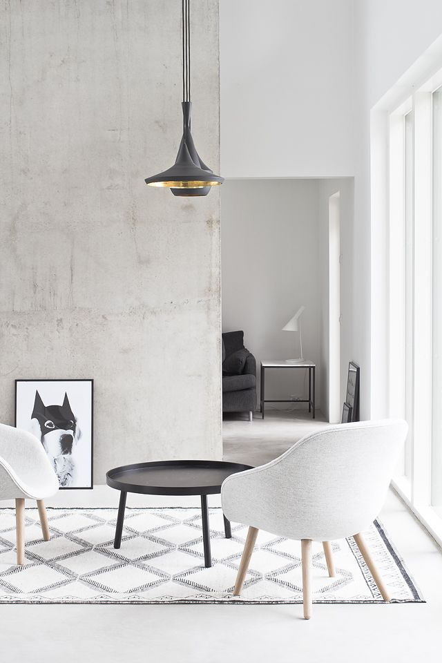 Black, white and concrete living. There are several armchairs in the market that will fit into your modern living area. The materials are various but all great: leather, wood, velvet, simple fabric. See our inspirations at http://goo.gl/Fiql7z
