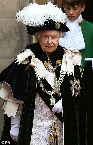 Queen Elizabeth leaves St Giles' Cathedral in Edinburgh after taking part in the ancient Knights of the Thistle service.