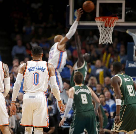 Oklahoma City's Russell Westbrook (0) gets his last assist for his 41st triple-double during an NBA basketball game between the Oklahoma City Thunder and the Milwaukee Bucks at Chesapeake Energy Arena in Oklahoma City, Tuesday, April 4, 2017. Westbrook tied Oscar Robertson's single-season triple-double record. Photo by Bryan Terry, The Oklahoman