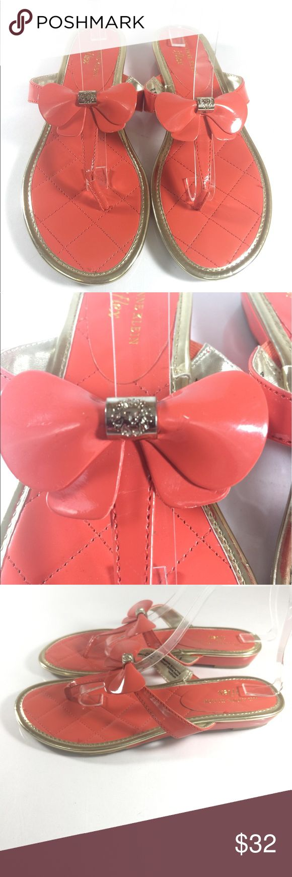 Anne Klein Akadal Orange Bow Flip Flops Size 7.5 Up for sale is this cute pair of Anne Klein iflex sandals. Coral orange with gold trim, bow detail with AK lionhead emblem! This pair is a must!  Women's Size US 7.5  CONDITION: Good Condition! Overall signs of minor wear. Please see photos Anne Klein Shoes Sandals