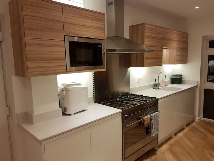 Cocobolo doors, Smeg range and built-in microwave.