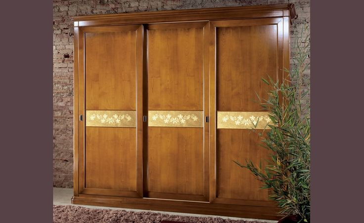 Elegant - Fiordipesco | Classic Collections Le Fablier | 3 sliding doors wardrobe | Measures in cm (LxDxH) 293x69x250 | Structure in hollow core wood veneered in cheerry wood | Standard equipment: 1 chest of drawers - 4 shelves - 4 clothes hangers  Doors available with gold leaf insert, flower mirror, lace glass