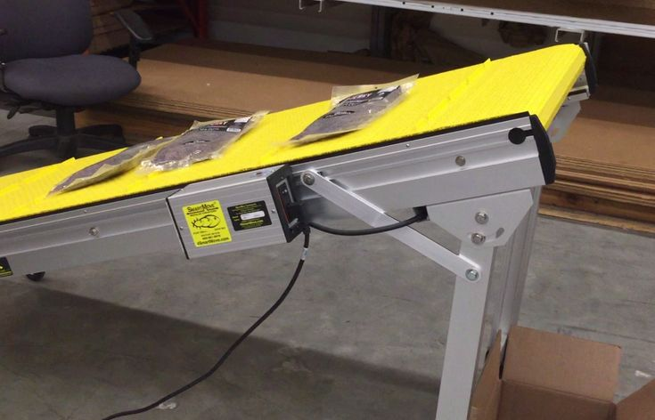 STACKING INCLINE CONVEYOR SYSTEM