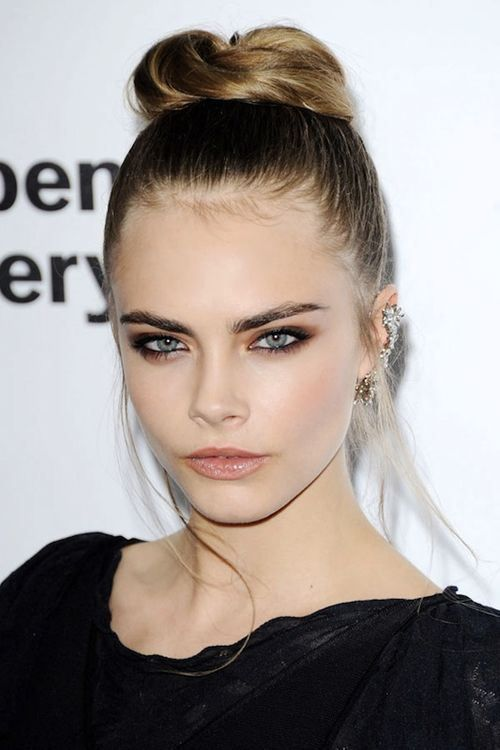 Cara-Delevingne-red-carpet-chic-in-Chanel-with-a-bun-and-earring