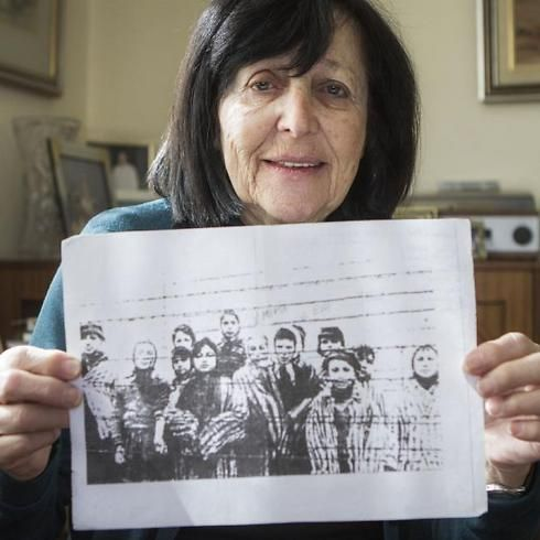 Marta Wise holds a famous photo that has become one of the most iconic images of the Holocaust (Photo: AP)