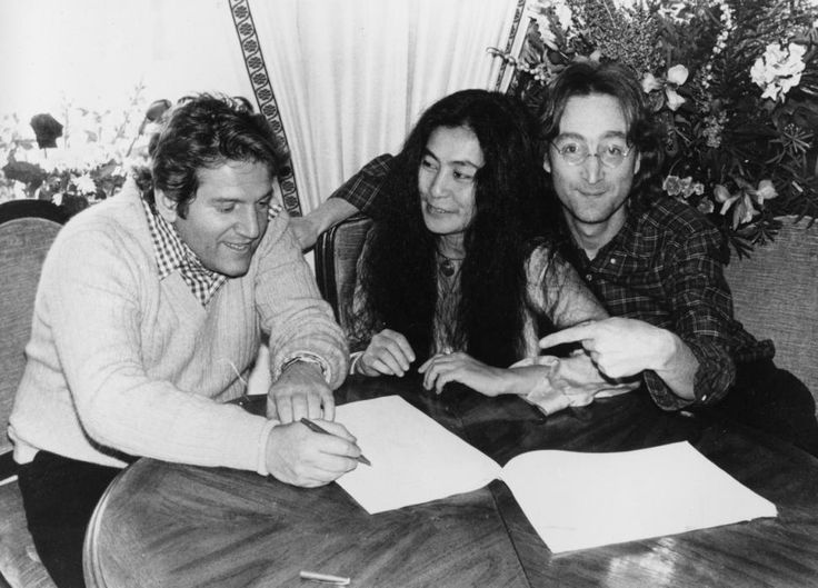 JANUARY 1977. Yoko Ono, center, and John Lennon, right, are shown with Allen Klein, president of ABKCO Industries Inc., and former Beatles manager.