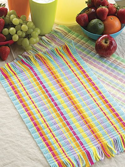 Scrap Happy Place Mats Plastic Canvas Pattern Download from e-PatternsCentral.com -- Weave a summery spell on plastic canvas with colorful leftover yarn to create these stylish and useful place mats.