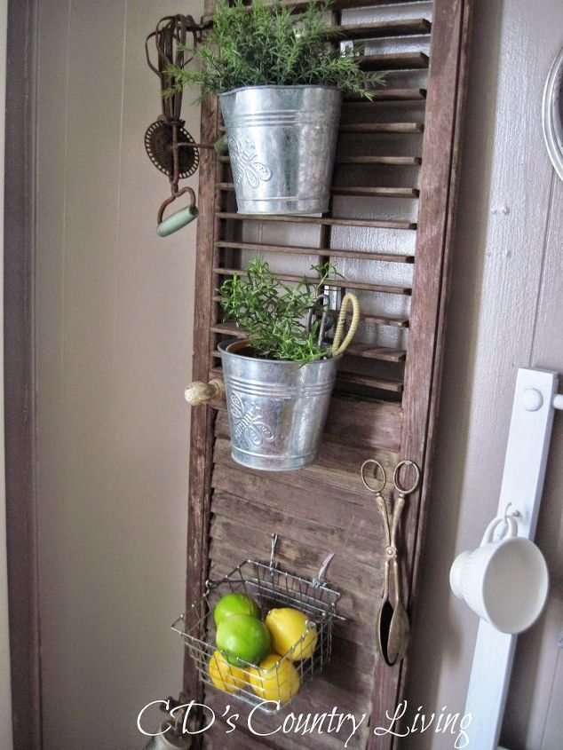 Wonderful repurpose of an old shutter into an herb planter and vintage kitchen tool display.