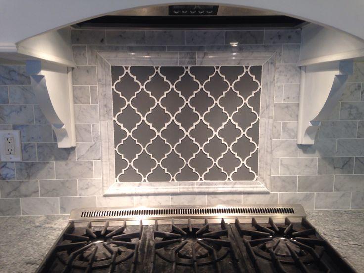 Grey Moroccan lattice backsplash accent behind range. Carrera Bianco subway tile, viscount white granite.