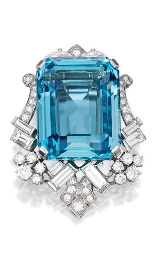 *PLATINUM, WHITE GOLD, AQUAMARINE AND DIAMOND BROOCH Set with a step-cut aquamarine weighing approximately 50.00 carats, the frame set with round, baguette and half-moon-shaped diamonds weighing approximately 4.90 carats; fitted with a pendant hook.